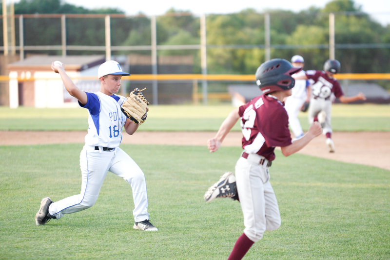 Poland's Matt Paparoois throws the ball to first to get Boardman's Matt Kay out during the 12u district championship game at Field of Dreams in Boardman on Thursday.