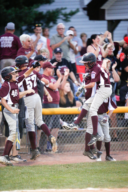 Boardman celebrates after getting ahead of Poland 4-2 in the fourth inning of the 12u district championship game at Field of Dreams in Boardman on Thursday.