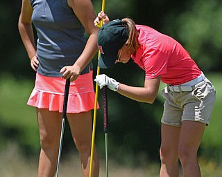 HERMITAGE, PENNSYLVANIA - JULY 12, 2018: Leah Benson of Hickory, right, reacts after missing a putt on the 8th hole, Thursday afternoon during the Vindy Greatest Golfer tournament at Tam O'Shanter in Hermitage. DAVID DERMER | THE VINDICATOR..Alyssa Rapp from Poland pictured.