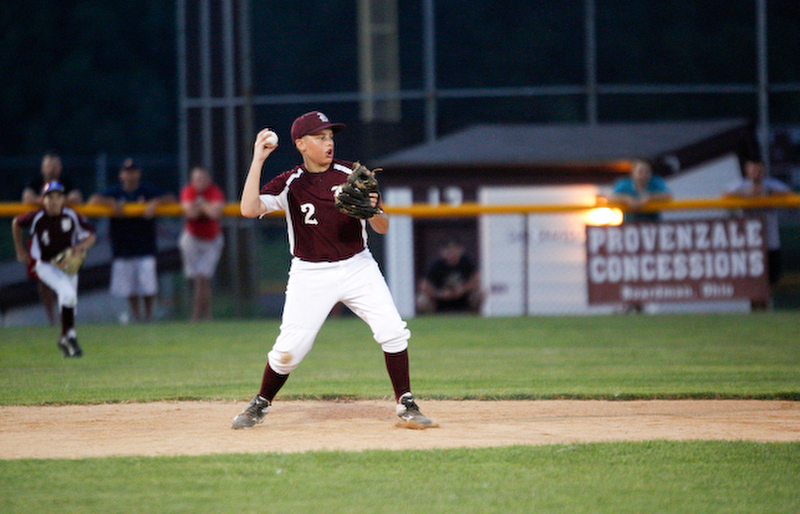 Boardman's Gavin Hyde throws the ball to first during the 12u championship game against Poland at Field of Dreams on Friday.