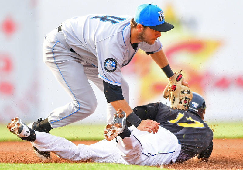 NILES, OHIO - JULY 14, 2018: Mahoning Valley Scrappers' Richard Palacios is tagged out by Chris Betts after attempting to steal first base in the first inning of a baseball game, Saturday, July 14, 2018, in Niles. Renegades won 1-0. DAVID DERMER | THE VINDICATOR