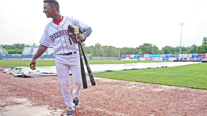 Mahoning Valley Scrappers player Ronny Dominguez returns to the dugout after the cancellation of Monday's game against the Hudson Valley Renegades at Eastwood Field in Niles.