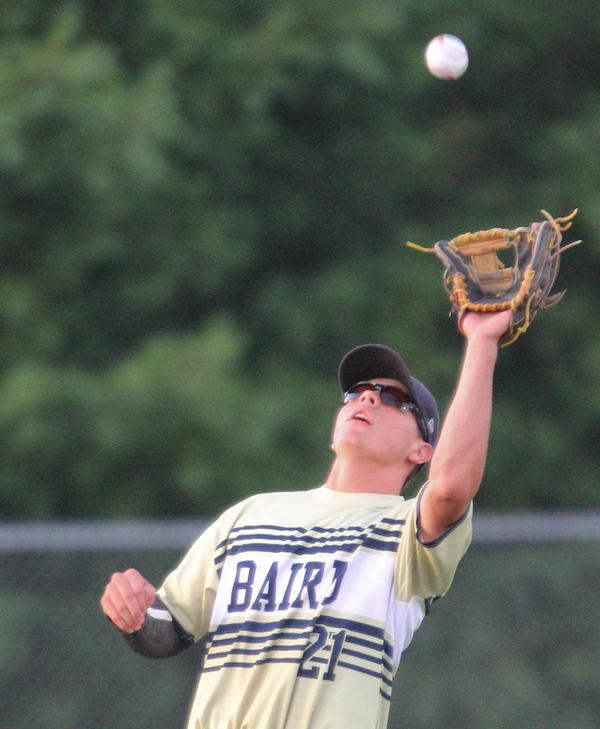 William D. Lewis The Vindicator  Baird's Jacob McCaskey(21) catches a fly ball during 1rst inning of 7-19-18 game with Troy at Cene.