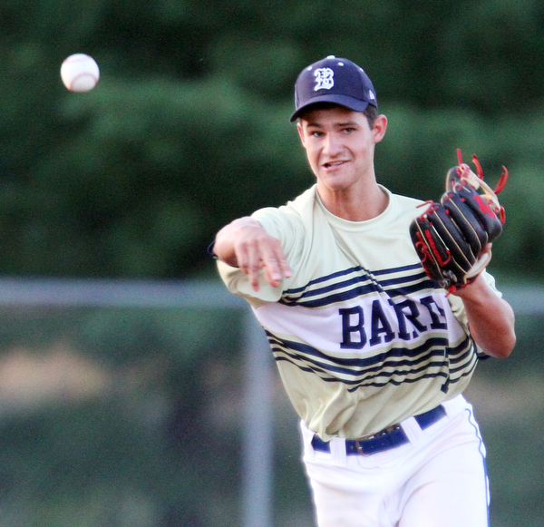 William D. Lewis The Vindicator  Baird's SS Luke Stauffer(7) throws to 1rst during 7-19-18 game with Troy at Cene.