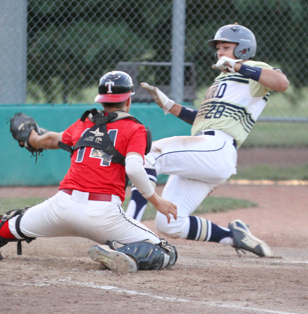 William D. Lewis The Vindicator Baird'sDylan Swarmer(28) scores while Troy catcher(14) triw to make the tag during 7-19-18 game with Troy at Cene.