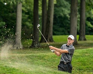 DIANNA OATRIDGE | THE VINDICATOR Seamus Chrystal from Ursuline hits a shot out of the bunker on  Hole 3 during the final round of the Greatest Golfer junior tournament at Avalon Lakes in Howland on Saturday.