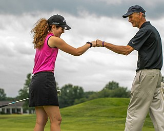 DIANNA OATRIDGE | THE VINDICATOR Canfield's Eileen McHale gets a congratulatory fist bump from Cortland's Jimmy Franks after sinking a long putt during final round of the Greatest Golfer junior tournament at Avalon Lakes in Howland on Saturday.