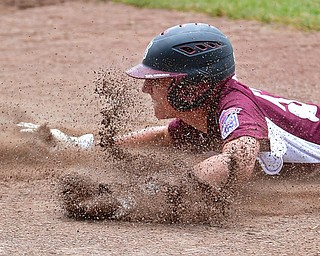 NORTH CANTON, OHIO - JULY 22, 2018: Boardman's Jack Ericson slides into third base to avoid being caught in a rundown in the fifth inning of a Little League baseball game, Sunday night in North Canton. DAVID DERMER   THE VINDICATOR