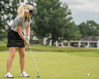 DIANNA OATRIDGE | THE VINDICATOR Kyra Woods, from Hermitage, sinks her putt during the final round of the Greatest Golfer junior tournament at Avalon Lakes in Howland on Saturday.