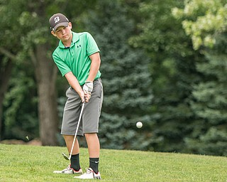 DIANNA OATRIDGE | THE VINDICATOR Gavin Pahanish, from South Range, chips on to the green during the final round of the Greatest Golfer junior tournament at Avalon Lakes in Howland on Saturday.