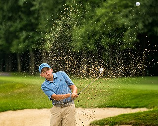 DIANNA OATRIDGE | THE VINDICATOR Nolan Williard, from Canfield, hits out of a bunker during the final round of the Greatest Golfer junior tournament at Avalon Lakes in Howland on Saturday.