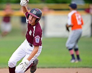 NORTH CANTON, OHIO - JULY 22, 2018: Boardman's Jack Ericson stumbles rounding second base while running to third base in the fourth inning of a Little League baseball game, Sunday night in North Canton. DAVID DERMER   THE VINDICATOR