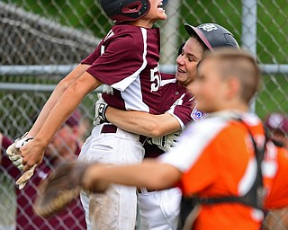 NORTH CANTON, OHIO - JULY 22, 2018: Boardman's Jack Ericson, left, and Dylan Barrett celebrate after scoring a run on a single by Evan Sweder hit in the fourth inning of a Little League baseball game, Sunday night in North Canton. DAVID DERMER   THE VINDICATOR