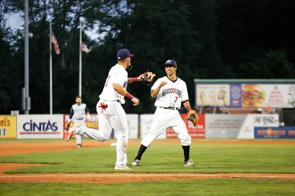 Tyler Freeman, right, and Henry Pujols celebrate after holding the Cyclones 0-1 in the fourth inning of Tuesday night's game.
