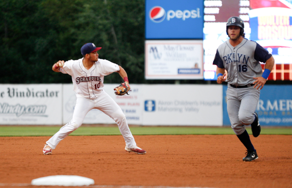 Henry Pujols throws the ball to first as the Cyclones's Kevin Hall runs past during Tuesday night's game.