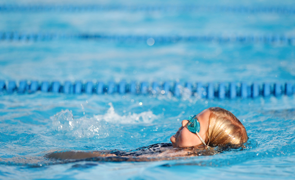 Rylynne Scriber, 6, with BTSC, competes in the 25Y Backstroke during the swim meet between Applewood Swim Club and Boardman Tennis and Swim Club at the Applewood Swim and Tennis Club on Wednesday.