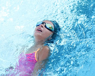 Anna Tsarnas, 8, with APP, competes in the 25Y Backstroke during the swim meet between Applewood Swim Club and Boardman Tennis and Swim Club at the Applewood Swim and Tennis Club on Wednesday.