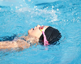 Celestina Cerneka, 7, with APP, competes in the 25Y Backstroke during the swim meet between Applewood Swim Club and Boardman Tennis and Swim Club at the Applewood Swim and Tennis Club on Wednesday.