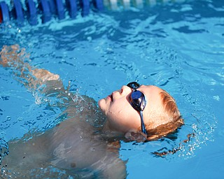 Landon Schmied, 6, with APP, competes in the 25Y Backstroke during the swim meet between Applewood Swim Club and Boardman Tennis and Swim Club at the Applewood Swim and Tennis Club on Wednesday.