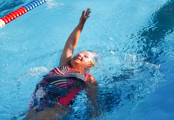 Lainey Hunt, 9, with APP, competes in the 25Y Backstroke during the swim meet between Applewood Swim Club and Boardman Tennis and Swim Club at the Applewood Swim and Tennis Club on Wednesday.