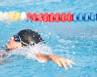 Tyler Perse, 9, with BTSC, competes in the 25Y Backstroke during the swim meet between Applewood Swim Club and Boardman Tennis and Swim Club at the Applewood Swim and Tennis Club on Wednesday.