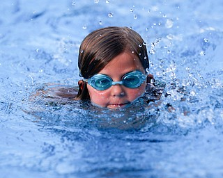 Rylynne Scriber, 6, with BTSC, competes in the 25Y Freestyle during the swim meet between Applewood Swim Club and Boardman Tennis and Swim Club at the Applewood Swim and Tennis Club on Wednesday.