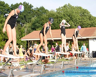 From left, Gianna Marino, 9, with APP, Ella Phillips, 9, with BTSC, Julia Pickens, 10, with APP, and Lydia Kenney, 10, with BTSC, get ready to jump into the pool to compete in the 25Y Freestyle during the swim meet between Applewood Swim Club and Boardman Tennis and Swim Club at the Applewood Swim and Tennis Club on Wednesday.