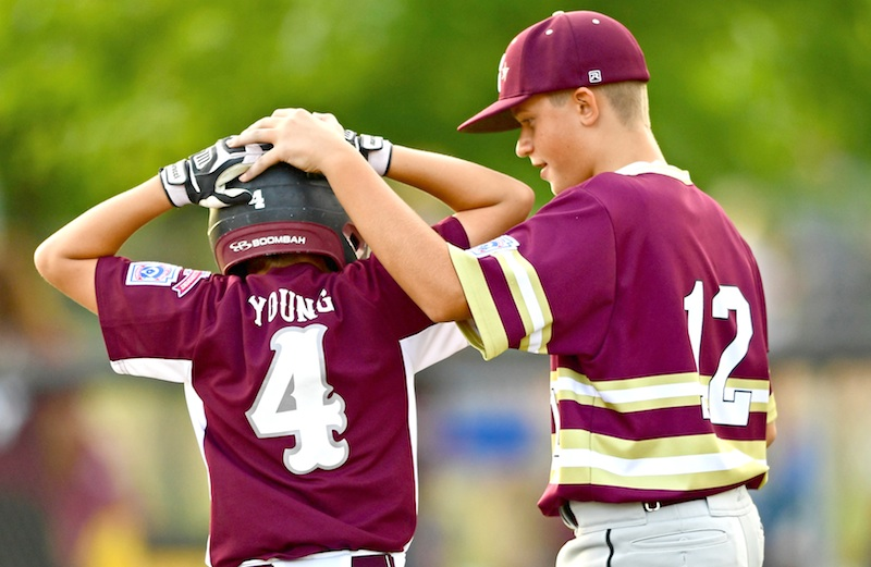 New Albany first baseman Max Purper (12) consoles Boardman batter Charlie Young after their game Thursday in the Little League 11-12 state tournament in North Canton. Boardman lost 3-1 to drop into the losers bracket. They could meet again on Saturday.