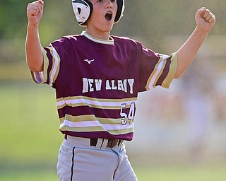 NORTH CANTON, OHIO - JULY 26, 2018: New Albany's Aidan Booth celebrates after hitting a two-RBI double in the fourth inning of a Little League baseball game, Thursday night in North Canton. New Albany won 3-1. DAVID DERMER | THE VINDICATOR