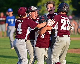 NORTH CANTON, OHIO - JULY 17, 2018: Boardman's Tyler Kirlik, center, is mobbed by his teammates including Dylan Barrrett, Charlie Young, Zach Ganser and Marty Stachowicz after hitting a walk off single with the bases loaded to beat Hamilton 5-4 in the sixth inning of a Little League baseball game, Friday night in North Canton. DAVID DERMER | THE VINDICATOR