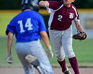 NORTH CANTON, OHIO - JULY 17, 2018: Boardman's Gavin Hyde, right, forces out Hamilton's Nick Brosivs at second base while throwing to first for a double play in the third inning of a Little League baseball game, Friday night in North Canton. Boardman won 5-4. DAVID DERMER | THE VINDICATOR