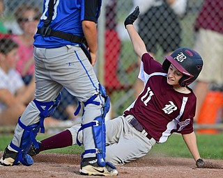 NORTH CANTON, OHIO - JULY 17, 2018: Boardman's Evan Sweder slides into home plate to score a run in the fourth inning of a Little League baseball game, Friday night in North Canton. Boardman won 5-4. DAVID DERMER | THE VINDICATOR