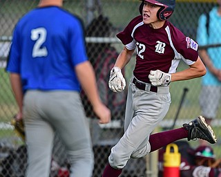 NORTH CANTON, OHIO - JULY 17, 2018: Boardman's Jack Ericson comes home to score after hitting a inside the park home run off Hamilton starting pitcher Jonathan Alcorn in the fifth inning of a Little League baseball game, Friday night in North Canton. Boardman won 5-4. DAVID DERMER | THE VINDICATOR