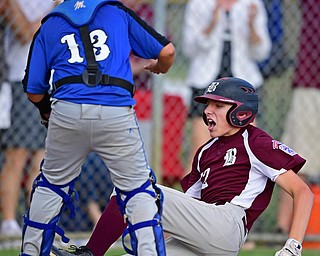 NORTH CANTON, OHIO - JULY 17, 2018: Boardman's Jack Ericson slides into home to score after hitting a inside the park home run off Hamilton starting pitcher Jonathan Alcorn in the fifth inning of a Little League baseball game, Friday night in North Canton. Boardman won 5-4. DAVID DERMER | THE VINDICATOR