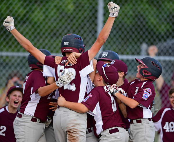 NORTH CANTON, OHIO - JULY 17, 2018: Boardman's Jack Ericson is mobbed by his tames after hitting a inside the park home run off Hamilton starting pitcher Jonathan Alcorn in the fifth inning of a Little League baseball game, Friday night in North Canton. Boardman won 5-4. DAVID DERMER | THE VINDICATOR