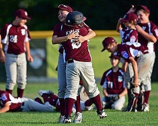 NORTH CANTON, OHIO - JULY 17, 2018: Boardman's XXX, front, is hugged by Caleb Satterfield after hitting a walk off single with the bases loaded to beat Hamilton 5-4 in the sixth inning of a Little League baseball game, Friday night in North Canton. DAVID DERMER | THE VINDICATOR