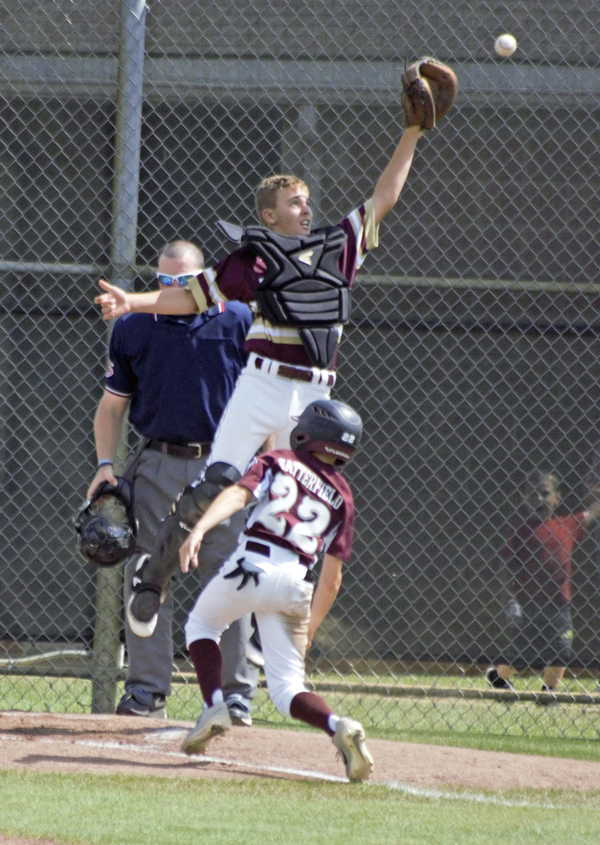 Caleb Satterfield scores the Boardman All-Stars' first run as New Albany catcher Ben Clark goes up for the ball in the Little League state championship game at North Canton Recreational Complex on Saturday afternoon.