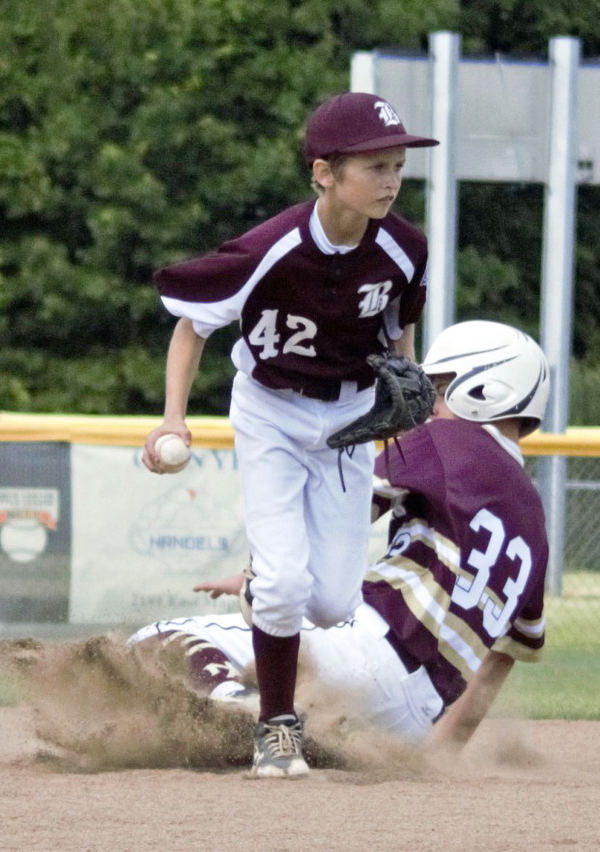 Matt Kay of the Boardman All-Stars forces New Albany's Charlie Oakleaf out at second base in the Little League state championship game at North Canton Recreational Complex on Saturday afternoon.
