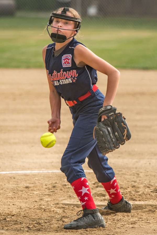 DIANNA OATRIDGE   THE VINDICATOR Austintown's Morgan Roby fires a pitch during the first inning of their 10U tournament game versus Canfield in Tallmadge on Monday. Canfield won 18-4 to advance to the championship.