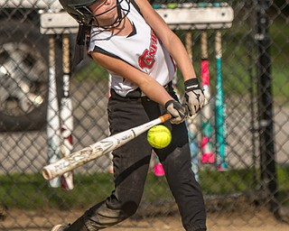 DIANNA OATRIDGE | THE VINDICATOR Canfield's Marina Koenig makes contact during 10U state tournament action against Austintown in Tallmadge on Monday. Canfield won 18-4 to advance to the championship.
