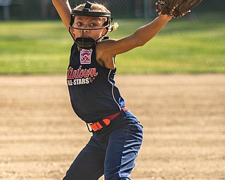 DIANNA OATRIDGE | THE VINDICATOR Austintown's Kali Ray delivers a pitch during their 10U tournament game against Canfield in Tallmadge on Monday. Canfield won 18-4 to advance to the championship.