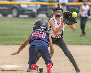 DIANNA OATRIDGE | THE VINDICATOR Austintown's Kali Ray dives back to third base as Canfield's Sam Economous catches the throw to third during 10U state tournament action in Tallmadge on Monday. Canfield won 18-4 to advance to the championship.