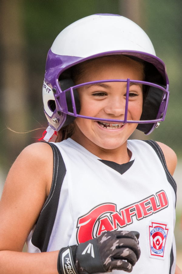 DIANNA OATRIDGE | THE VINDICATOR Canfield's Riley Billak smiles after drawing a walk during the Cardinals' convincing 18-4 win over Austintown during 10U state tournament action in Tallmadge on Monday.