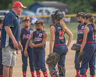 DIANNA OATRIDGE | THE VINDICATOR Members of the Austintown 10U softball team convene on the mound during a timeout during 10U state tournament action in Tallmadge on Monday. Canfield won 18-4.