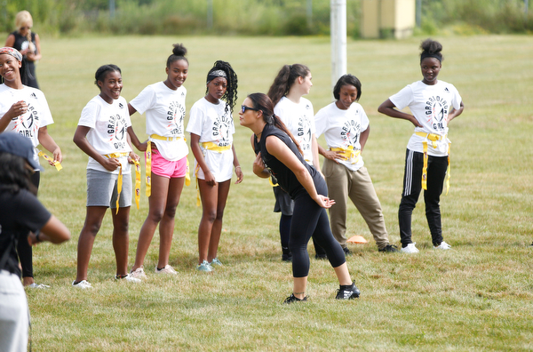 Jen Welter, the first female NFL assistant coach, talks to girls participating in the Grrridiron Girls Flag Football Camp about taking yourself seriously at the camp at Glacier Field in Struthers on Tuesday. EMILY MATTHEWS | THE VINDICATOR
