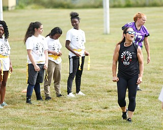 Jen Welter, the first female NFL assistant coach, leads a warm-up at the Grrridiron Girls Flag Football Camp at Glacier Field in Struthers on Tuesday. EMILY MATTHEWS | THE VINDICATOR