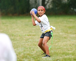 Aliyah Giles, 6, of Boardman, gets ready to throw the ball at the Grrridiron Girls Flag Football Camp at Glacier Field in Struthers on Tuesday. EMILY MATTHEWS | THE VINDICATOR