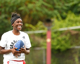 Iazia Wyan, 15, of Youngstown, smiles after catching the ball at the Grrridiron Girls Flag Football Camp at Glacier Field in Struthers on Tuesday. EMILY MATTHEWS | THE VINDICATOR