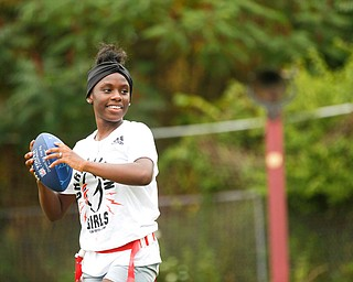 Iazia Wyan, 15, of Youngstown, gets ready to throw the ball at the Grrridiron Girls Flag Football Camp at Glacier Field in Struthers on Tuesday. EMILY MATTHEWS | THE VINDICATOR