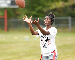 Iazia Wyan, 15, of Youngstown, gets ready to catch the ball at the Grrridiron Girls Flag Football Camp at Glacier Field in Struthers on Tuesday. EMILY MATTHEWS | THE VINDICATOR